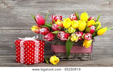 Spring Tulips In Wooden Basket, Red Polka-dot Gift Box. Happy Mothers Day, Romantic Still Life, Fres