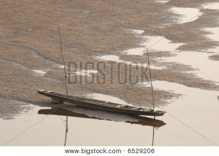 Two Boats On The Riverbed Of Mekong