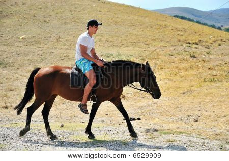 Man riding a horse it's the first time poster