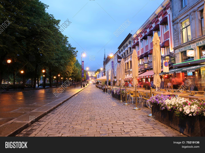 0c7a5021 Oslo, Norway - June 5, 2014: The main Street in Oslo by night - Karl Johans  Gate