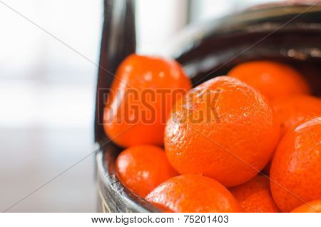 Mandarin Oranges In A Wooden Basket