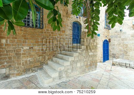 Typical view of Jaffa's narrow old alley. Jaffa is part of Tel Aviv, Located to the south and known as an ancient port city that goes back to the bronze age. poster