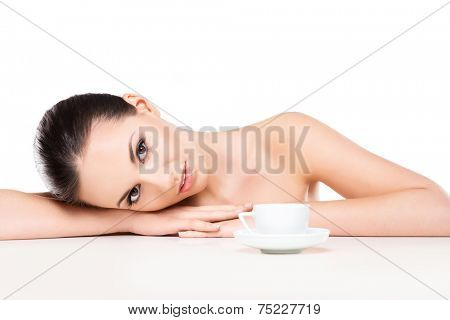 Portrait of young, beautiful and healthy woman drinking morning coffee isolated on white
