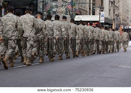 NEW YORK - NOV 11, 2013: Members of the US Army wearing ACU's march during the 2013 America's Parade held on Veterans Day in New York City on November 11, 2013.