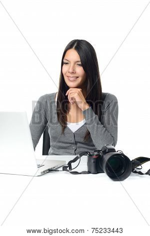 Photographer Smiling In Satisfaction At Her Images