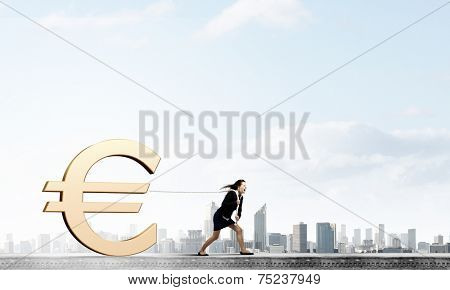 Young businesswoman pulling euro sign with rope poster