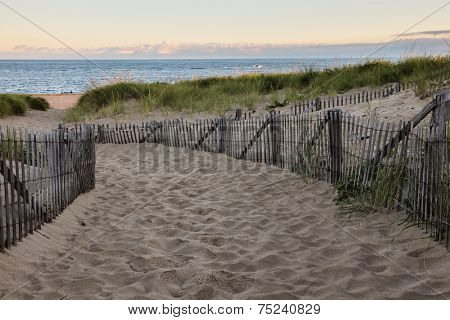 Wooden fence with Atlantic ocean early morning near Provincetown in Cape Cod , Massachussets, USA