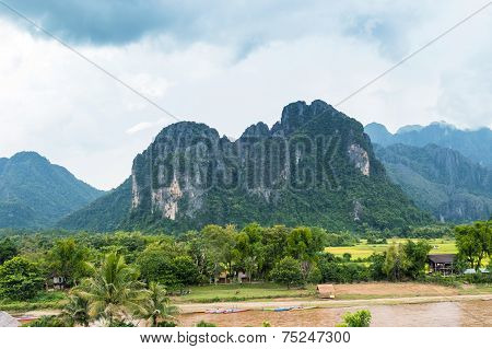 VANG VIENG LAO P.D.R. - October 24 : Unidentified tourists are rowing kayak boats in Song River on O