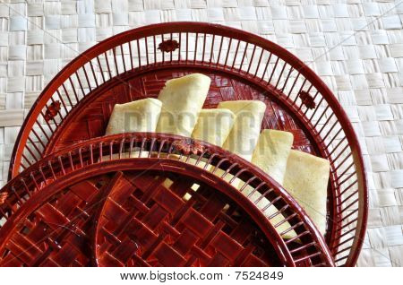 Egg rolls in bamboo basin with cover