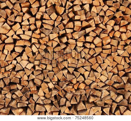 stack of split logs in a woodpile