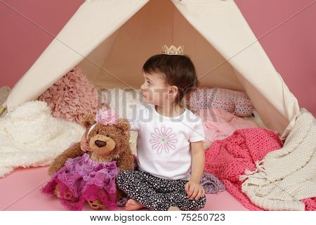 Toddler child kid engaged in pretend play with princess crown and teepee tent poster