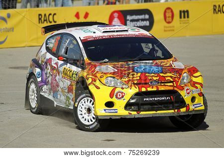 BARCELONA - OCT,23: Karl Kruuda of Estonia and Martin Jarveoja of Estonia in their FORD Fiesta S2000 during the Rally Catalunya-Costa Daurada of the WRC Spain on October 23, 2014 in Barcelona, Spain
