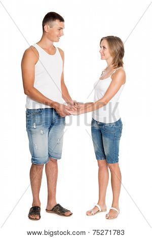 Beautiful young couple in love in breeches and undershirts