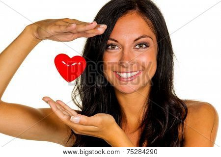 a loving young woman holds a heart in his hand