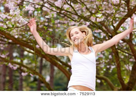 Happy Woman And Cherry Blossom