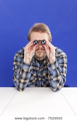 Man Watches With Binoculars