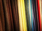 Selection of colorful fabrics in a textile store. poster