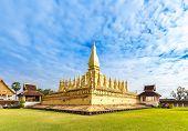 Golden Wat Thap Luang in Vientiane Laos. poster