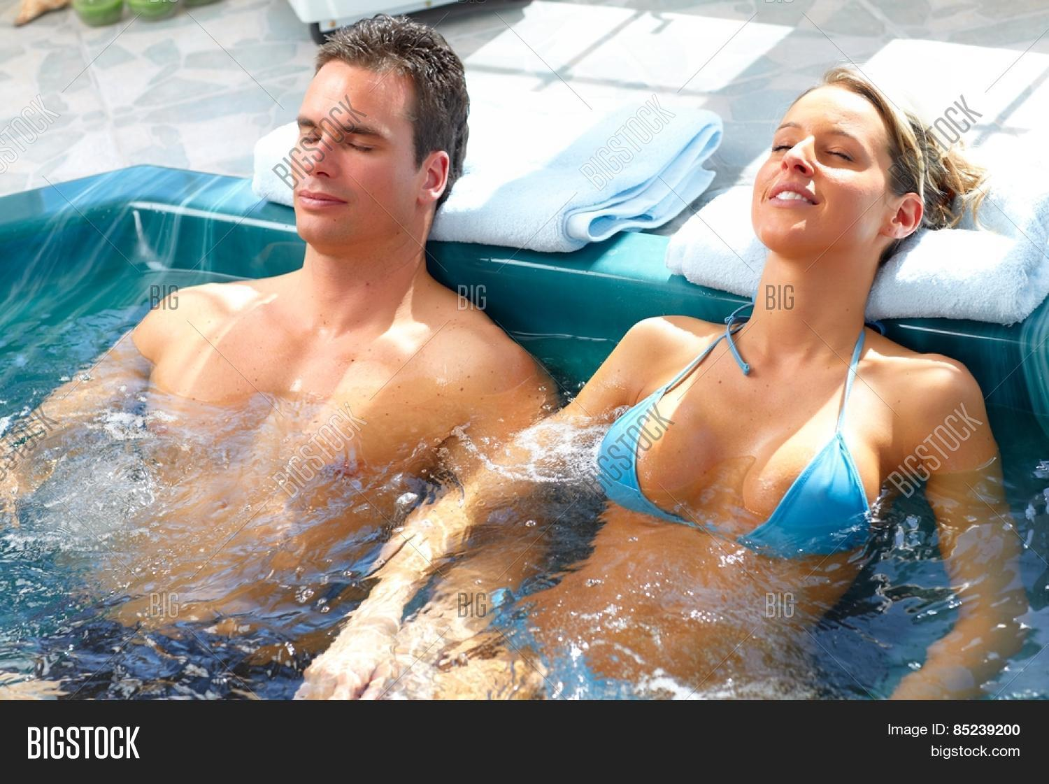 young couple relaxing hot tub image photo bigstock. Black Bedroom Furniture Sets. Home Design Ideas