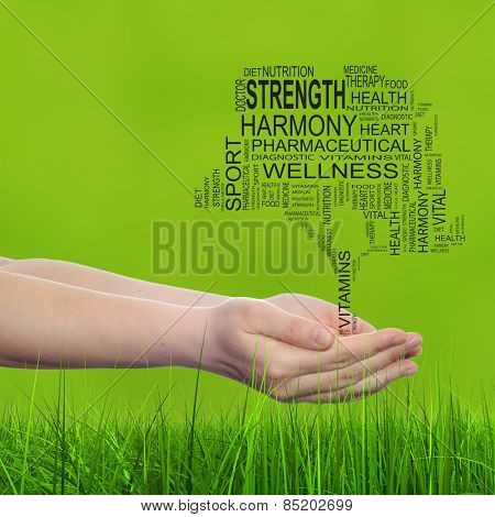 Concept conceptual black text word cloud tagcloud tree in man or woman hand on green blur grass background, metaphor to health, nutrition, silhouette, diet, body, energy, medical, sport, heart science