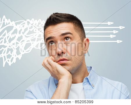 emotions, chaos and people concept - bored middle aged man over gray background
