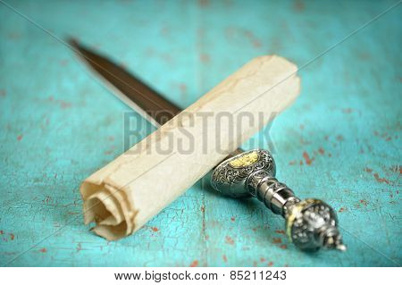 Vintage scroll and Roman sword on old table - Focus on scroll