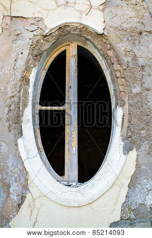 Ragged Oval Window In An Old Building