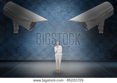 Thinking businesswoman against dark grimy room