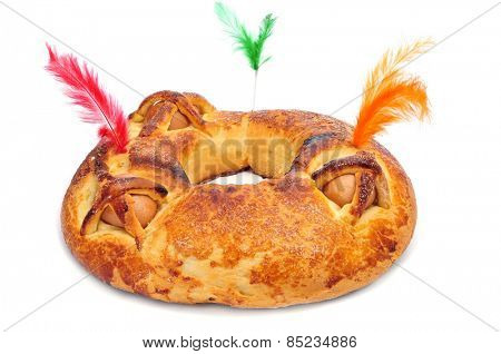 a traditional mona de pascua typical in Spain, a cake with boiled eggs eaten on Easter Monday, on a white background