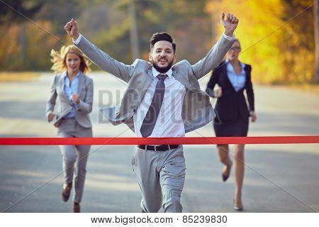 Businessman reaching finish line