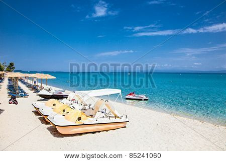 Beautiful Hanioti beach with Colorful pedalos docked on Kasandra peninsula, Halkidiki,  Greece. poster