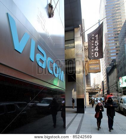NEW YORK CITY - FEB. 25, 2015:  A pedestrian walks past the headquarters of Viacom. Viacom, Inc. is an American global mass media company
