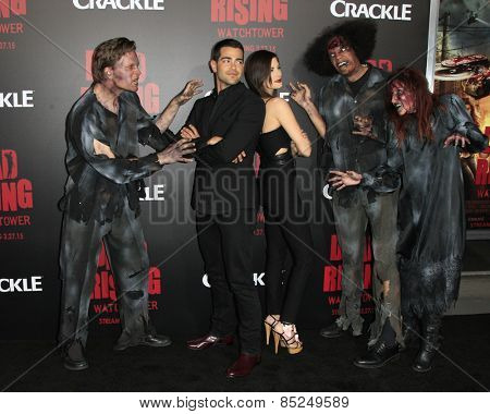 LOS ANGELES - MAR 11:  Jesse Metcalfe, Meghan Ory at the