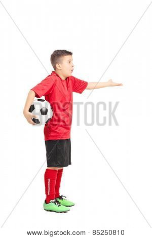 Full length portrait of a junior football player gesturing displeasure isolated on white background