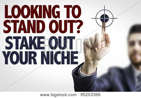 Business man pointing the text: Looking to Stand Out? Share Out Your Niche