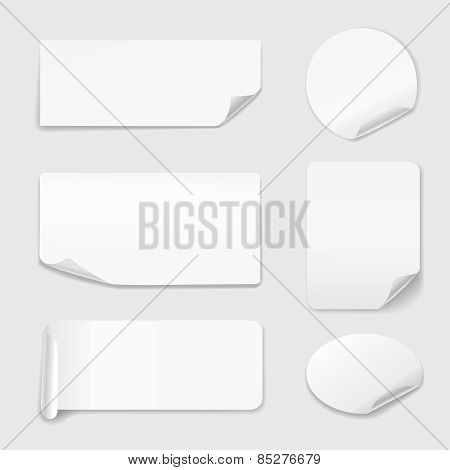 White Stickers - Set of paper stickers isolated on white background.