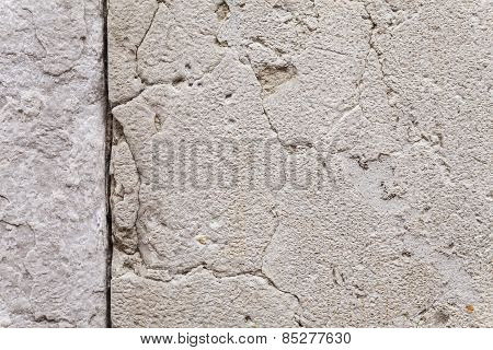 Texture Of Cracks In An Ancient Stone Wall.