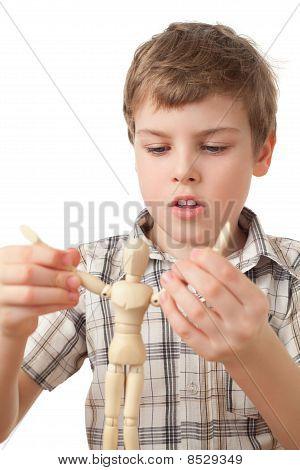 Boy Is Played By Wooden Little Manikin