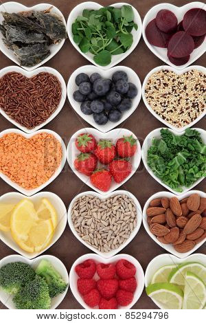 Health food for a skincare diet in heart shaped porcelain bowls.