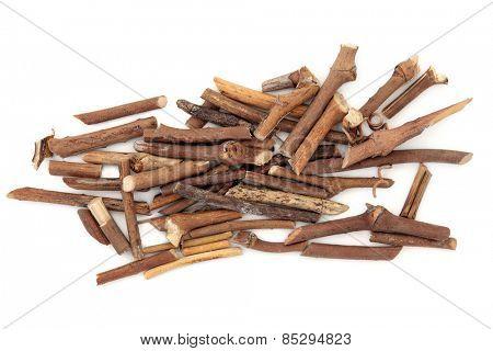 Briar wist herb used in alternative medicine over white background.