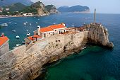 A view of picturesque cliff of Petrovac in Montenegro poster