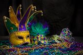 A venetian, mardi gras mask or disguise on a dark background poster