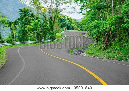 An Empty S-curved Road.