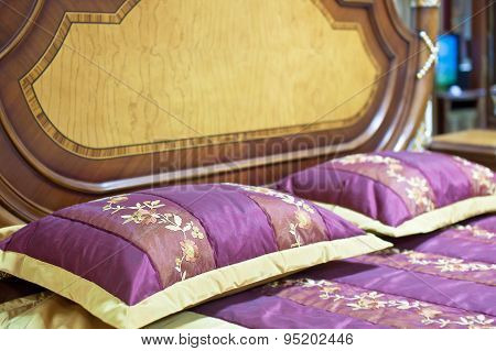 Part of a double bed with decorative headboard