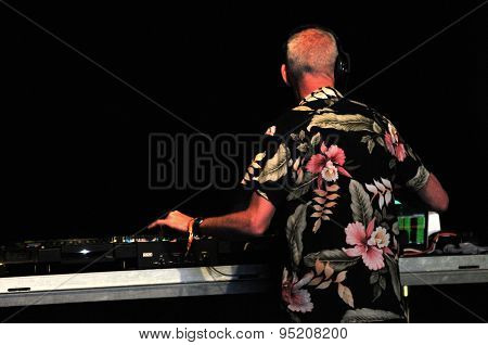 Fatboy Slim mixing during a live concert