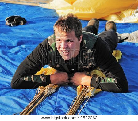The Young Sportsman Lays On The Parachute