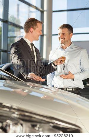 Car Dealer Giving Client Keys