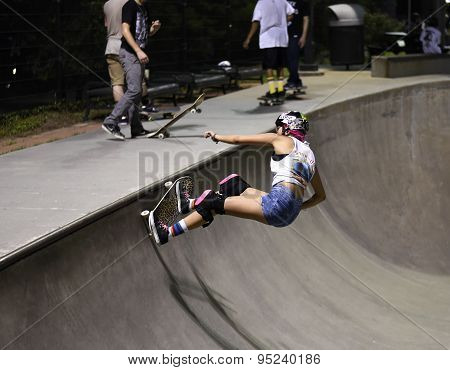 Houston, Texas- July 7, 2015: Skateboarder at a skate park doing a trick