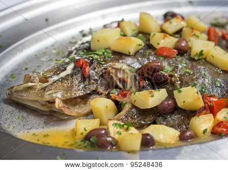 Baked Flounder Fish With Potatoes, Olives And Tomates