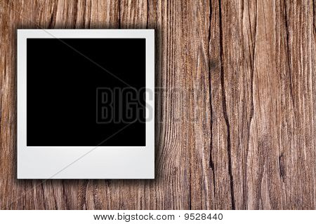 Blank Photo On Grunge Wood Background